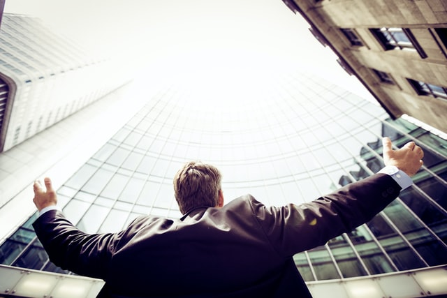 business-man-looking-at-buildings